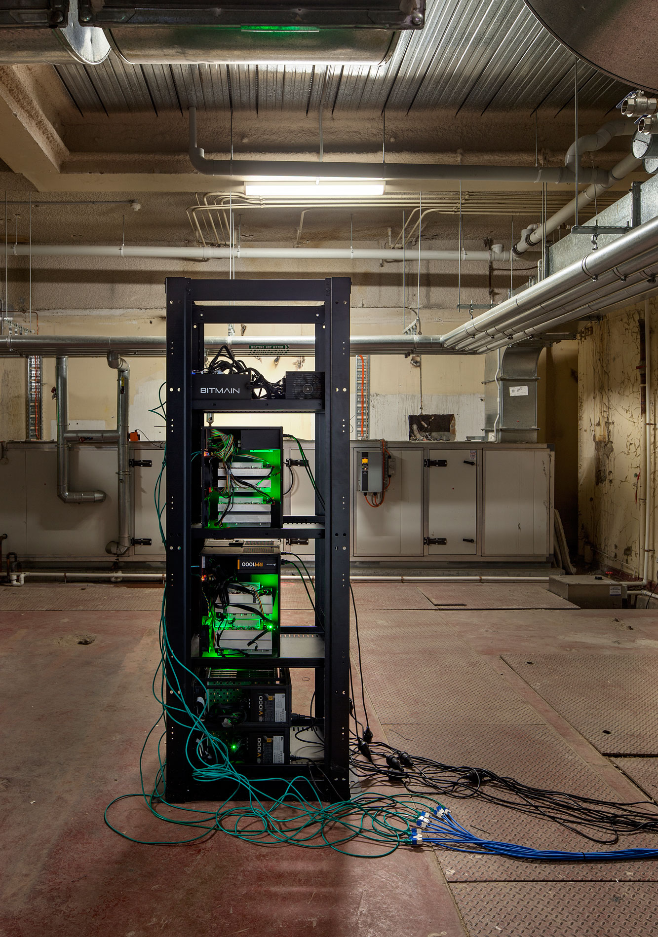 Nicholas Mangan, *Limits to Growth*, 2016, 9 terrahash Bitcoin ASIC mining rig. Installation detail, basement boiler room of Monash University Museum of Art, Melbourne, 2016. Photographer: Andrew Curtis.