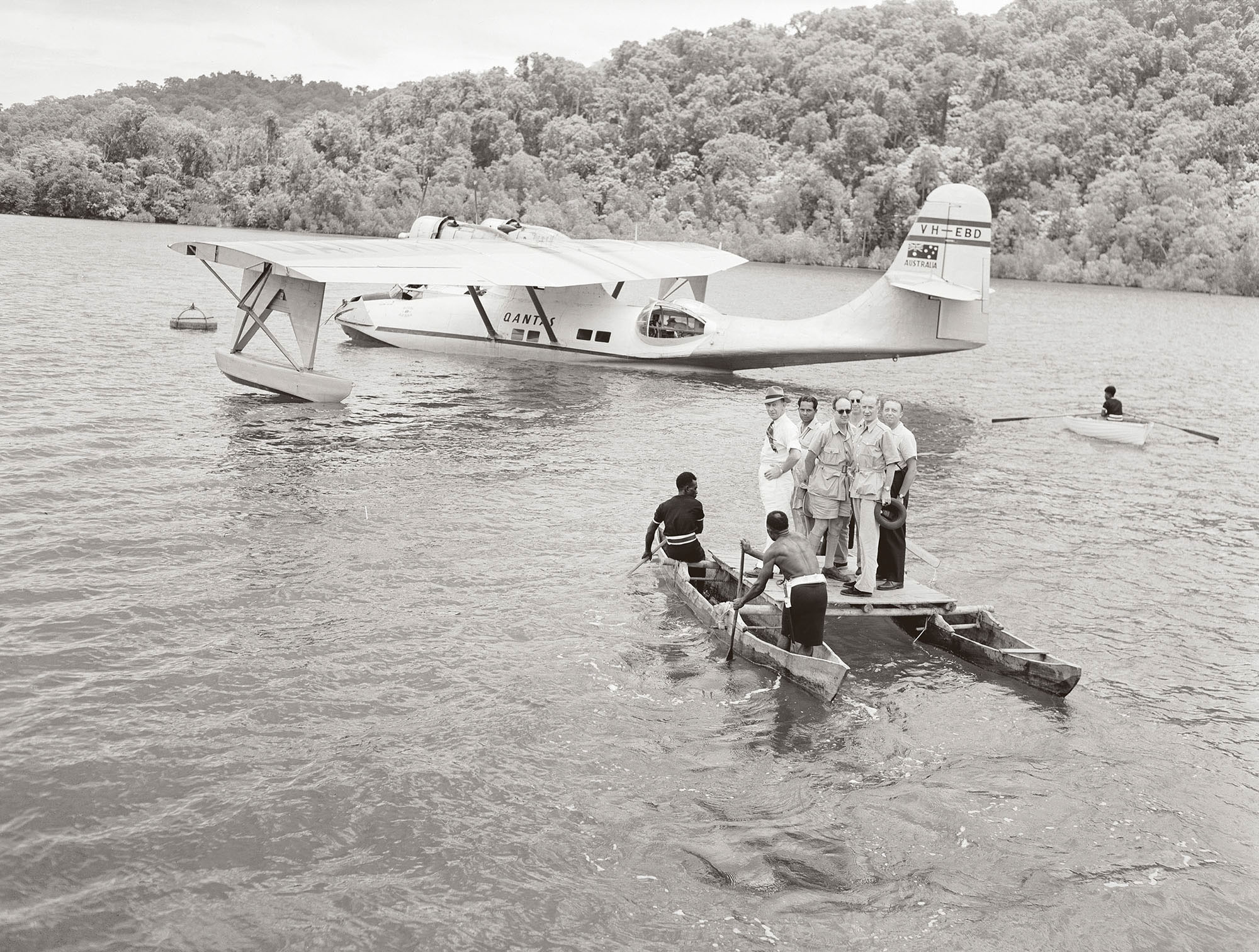 Members of the UN arrive on Tonelei Harbour at the southern end of Bougainville Island. Photographer: W. Brindle. Collection of the National Archives of Australia.